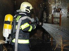 Požár bytu v Bohnicích.