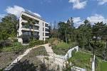 Barrandovská zahrada. Luxusní byty v zahradě prvorepublikové vily na Barrandově svého kupce již našly. U jiných nadstandardních projektů však zájem o koupi klesá.