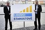 Petr Gazdík a Pavel Bělobrádek představují nové volební logo.