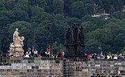Celé slavnosti začaly na Pražském hradě v katedrále Sv. Víta, kde celebroval mši svatou arcibiskup olomoucký Jan Bosco Graubner. Poté se vydalo procesí na Karlův most.