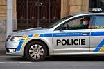 Prázdné ulice Prahy a lidé s rouškami 18. března 2020. Policejní hlídka na Václavském náměstí.