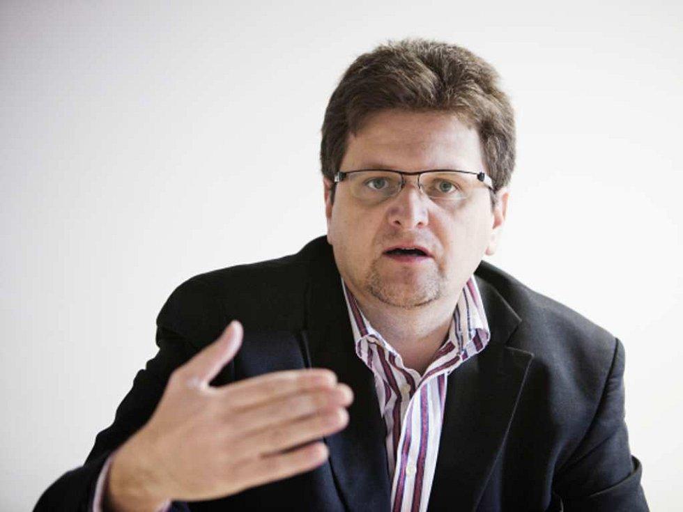 Novinář Pavel Šafr.