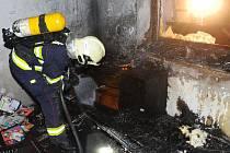 Požár domu v Hrdlořezích.