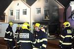Požár garáže v rodinném domě v Praze nepřežil jeden člověk, dalších 27 muselo dům opustit.