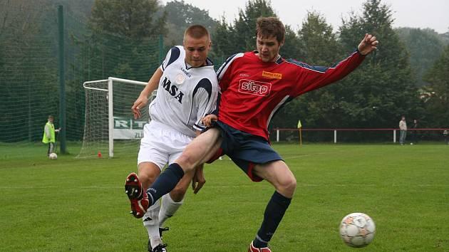 David Krajcar (v červeném) má za sebou první zkušenoti v divizi.