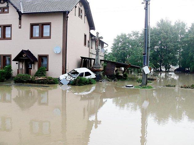 Práce po povodních stále pokračují. Ilustrační foto.