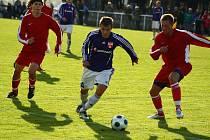 Fotbalisté Nového Jičína (v červeném) prohráli v Mohelnici.