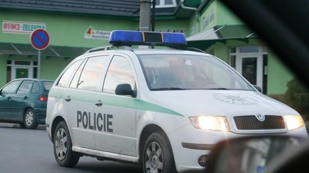 S policií v patách. Ilustrační foto