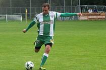 Fotbalisté Bzence nezvládli duel ve Slavičíně. Nepříjemné porážce nezabránil ani záložník Libor Škodík (na snímku).
