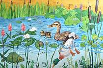 Snímek znázorňuje život ve vodě a na břehu.