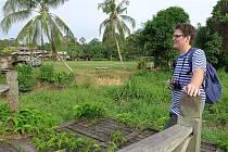 Cestovatelé v Bankoku a na Borneu.