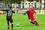 Blanenští fotbalisté (v červeném Haris Harba) v neděli podlehli Viktorii Žižkov 1:2.
