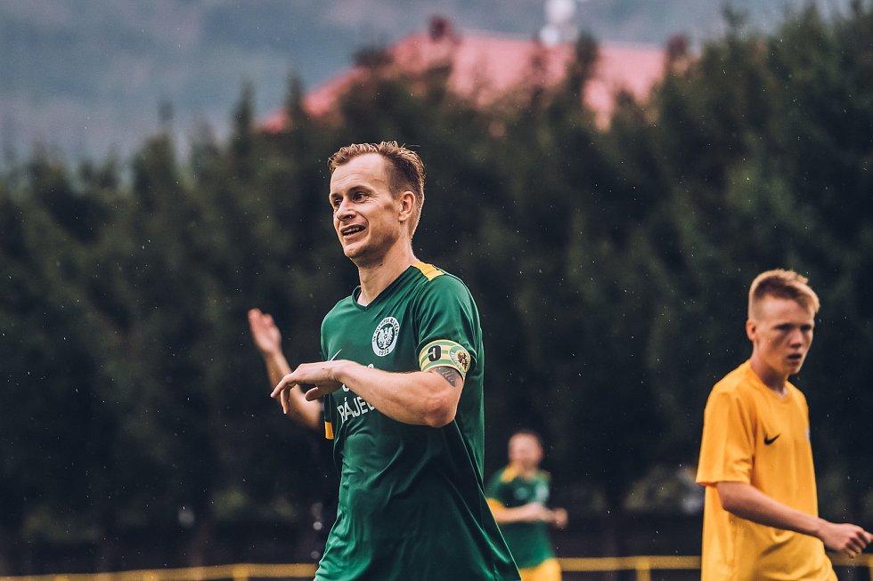 Fotbalisté Ráječka (v zeleném) při utkání s brněnskou Spartou.