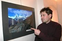 Ivan Poul mladší u jedné ze svých fotografií.