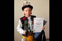 Dětští zpěváčci lidových písní z celého Slovácka soutěžili v neděli 21. dubna v Lužicích. Mezi 32 vítězi regionálních kol se znovu prosadil talentovaný Břeclavan Tomáš Harvánek (na snímku).