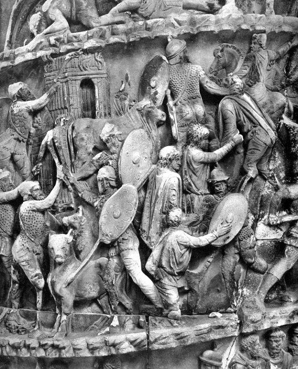 Římští vojáci při plenění germánské vesnice, scéna ze sloupu Marca Aurelia v Římě