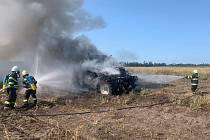 Požár traktoru u Božic.