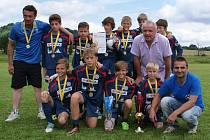Vítězný tým s Ladislavem Vízkem.