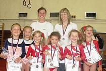 Mladé gymnastky Doks  pod vedením svých trenérek prokázaly své kvality na silně obsazených závodech v našem hlavním městě.