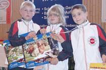 Zlatá trojice. Daniel Kobr, Nikita Melzerová a Kamil Novák.
