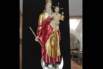 Zrestaurovaný originál sochy Panny Marie s Ježíškem umístěný v rousínovské místní části Rousínovec.