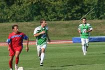 V nové sezoně se opět střetly celky Vyškova (v červeném) a Rousínova (zelenobílí). Z výhry se nakonec radoval Rousínov.