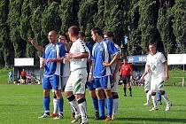 Rousínovští fotbalisté v utkání proti Rajhradu.