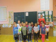 Snímky zachycují prvňáčky ze základní školy v třinecké městské části Nebory. Třídní učitelkou prvního ročníku je Miroslava Čmielová.