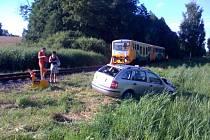 Nehoda vlaku s osobním automobilem.