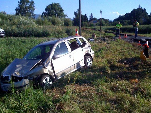 Nehoda vlaku sosobním automobilem.