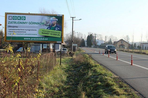 Uhraničních přechodů si OKD zaplatilo billboardy, kterými chce přilákat polské horníky do firmy. Podobně těžaři cílí také na Slováky.
