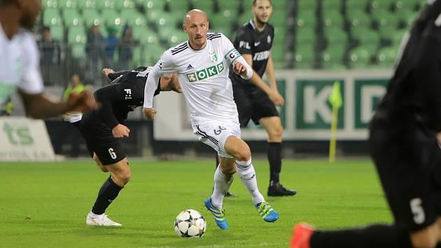 Marek Janečka (v bílém) a jeho spoluhráči by chtěli navázat na skalp Jablonce.