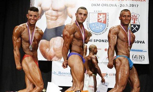 Sebastian Otisk (uprostřed) získal vOrlové mistrovský titul.