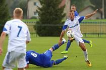 Petrovičtí (v bílém) poprvé v nové sezoně vyhráli.