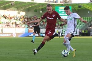 Tomáš Ostrák (v bílém) je v ligovém záložním výběru české reprezentace.