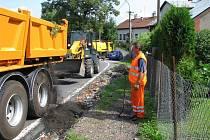 Oprava vodou poškozené silnice
