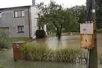 Rozlitá říčka Petrůvka potrápila obyvatele Petrovic u Karviné