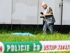 Policejní technik na místě tragické události.