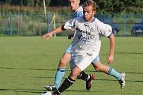 Jan Lukan, autor hattricku a nejlepší hráč sobotního zápasu (v bílém).