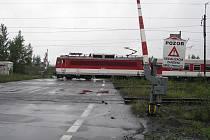 Porouchaná signalizace u železničního přejezdu