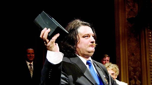 Andrij Shkurhan. Ukrajinský zpěvák získal ocenění za postavu hraběte Luny v Trubadúrovi.