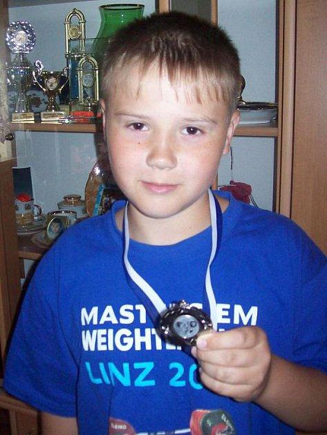 Ondřej Tchurz se stříbrnou medailí.