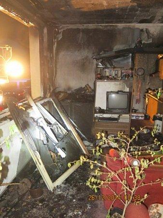 Následky požáru domácnosti.