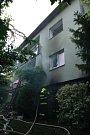 Následky výbuchu v domě ve Strahovicích.
