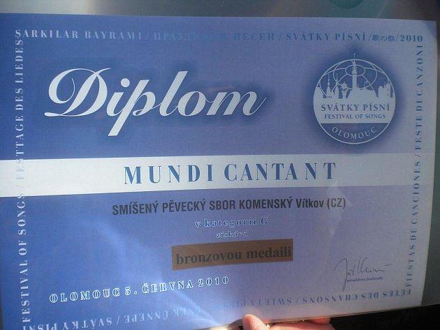 Ocenění za vystoupení vítkovského sboru v Olomouci.
