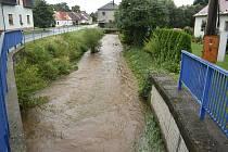 Rozvodněný potok Krasovka v Radimi, středa 19. srpna 2020.