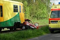 Srážka osobního vlaku s automobilem v Rumburské ulici ve Šluknově.