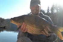Mirek na rybách na přehradě Slapy.